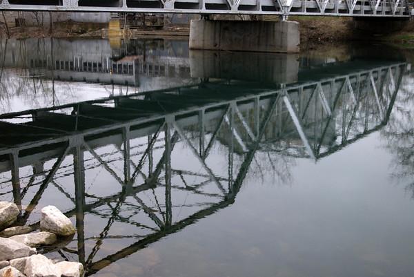 A winter reflection of the Finley River bridge in Ozark, MO.