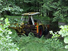 A tractor/JCB abandoned in the woods....random!