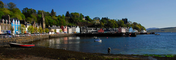 Panorama of colorful buildings lining the waterfront - Tobermory Harbour, Scotland