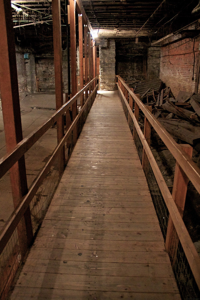 The wooden walkways were built for the tours. I guess so no one trips and sues the city?