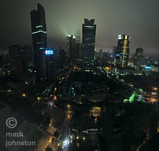 A foggy evening settles over Shanghai.  Looking east, with Kerry Center at right across Nanjing Rd., and Dong Hai Plaza at center.