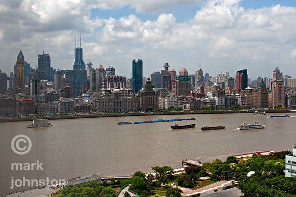 Some of Shanghai's tallest buildings as a backdrop to the Bund from the Pudong side of the Huangpu River facing east, including the pointed Tomorrow Square building,  and the twin antennae on the Shimao International Plaza building.