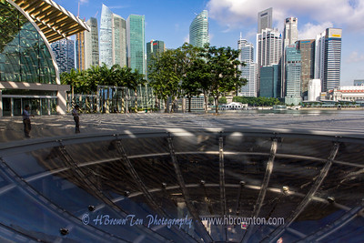 Skyline above and window below into Marina Bay Sands entertainment complex