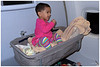 """4th year Pic 364- July - 02 2013. <span style=""""color:yellow""""> Anika in Bassinet Seat  </span> -  on board Singapore Airlines to Singapore <span style=""""color:cyan"""">Critiques welcome! </span> Hello friends! I have been away for a long time but hope and aim to be here on a daily basis now. Too many things were happening at once and could not cope with posting pictures and commenting on fine work of friends here. I am back at my old office, the renovations are almost over and it's good to be back. After that our whole family took a holiday for 10 days to Singapore. We were seven of us: from my elder sister Urvashi, who stays with us; to Anika! It was a wonderful holiday with the family especially since it was a first trip abroad for the eldest and the youngest!  Hope you will enjoy the pictures I'll be putting up. Cheers!  A Bassinet Seat is provided by certain airlines for long duration flights. This one was removable but she was allowed to use it only for sleeping, maybe they didn't want kids to jump out! :-)  This pic was taken just when she had just got up.  <span style=""""color:cyan"""">Special thanks to all those who wrote personally to check about my absence. </span>"""