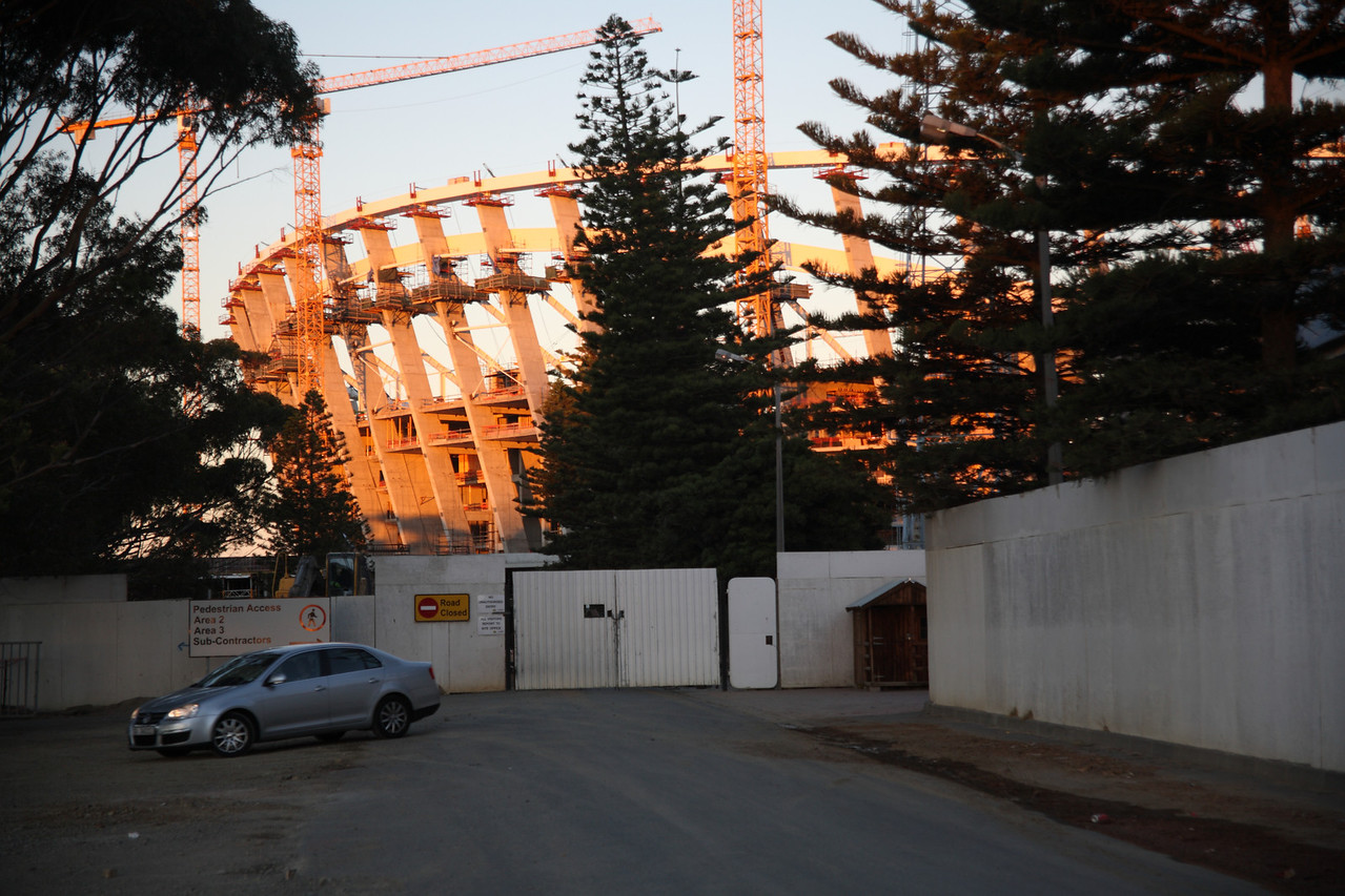 Cape Town Stadium, Green Point, South Africa, still under construction, at sunset