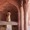 An Indian couple marvels at the architecture of the Agra Fort.