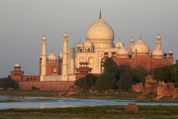 The Taj Mahal turns orange during the sunset.