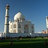 Visitors sit on the lawn to rest as they watch the Taj Mahal in awe.