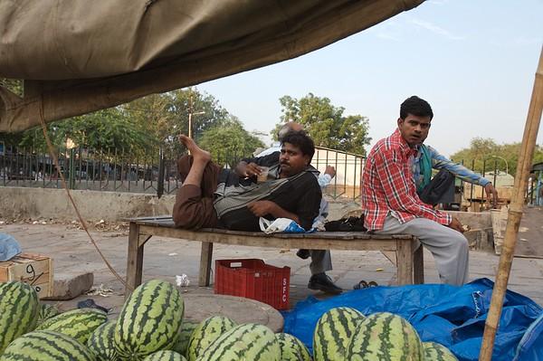 A vendor enjoying a cup of tea, Delhi.