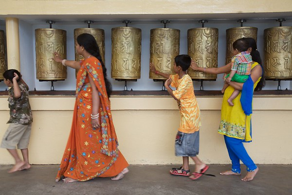 Visitors turn prayer wheels as they pass through the Namgyal Gompa, Mcleod Ganj.