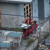 Buddhist monks enjoying dinner on the rooftop.