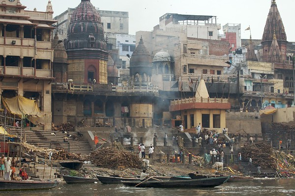 """Manikarnika Ghat is the main burning ghat and the most auspicious place for a Hindu to be cremated. Dead bodies are handled by outcasts known as doms, and they are carried through alleyways of the old city to the holy Ganges on a bamboo stretcher swathed in cloth. The corpse is doused in the Ganges prior to cremation"" -Lonely Planet"