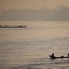Fisherman in the morning light on th Mekong River.