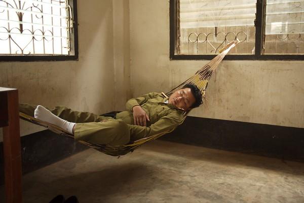 Laos soldier taking a nap.