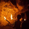 A group of local kids brought us into a cave and gave us a private tour. The torches are dried bamboo sticks.