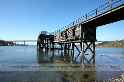 Burton Ferry, looking towards the Cleddau Bridge. The pier originally belonged to Trinity House.