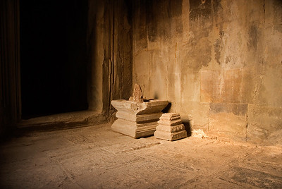 Interior stone room with light from setting sun silhouetting stone capitals-Angkor Wat-Cambodia