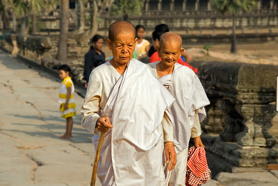 Buddhist nuns on causeway at Ankgor Wat-Causeway at Angkor Wat-Cambodia