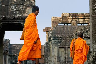 Buddhist monks in saffron robes walking inside ruins-Angkor Wat-Cambodia