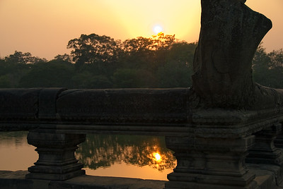 Railing near Naga causeway silhouetted by setting sun-Angkor Wat-Cambodia