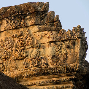 Exterior building detail showing stone carvings.-Angkor Wat-Cambodia