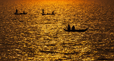 Fishermen silhoutted by setting sun-Chong Khneas-Cambodia
