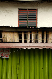 Green shop front shutters with red second story window-Street Scene-Melaka-Malacca Town-Malaysia
