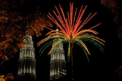Palm made of red and green lights with the Petronas Twin Towers in the background-Petronas Twin Towers-Kuala Lumpur-Malaysia
