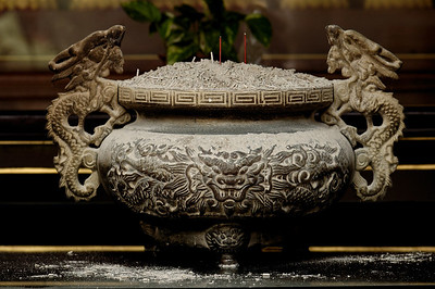 Cast iron incense burner with dragon handles covered with ash-Chinese Settlement-Melaka-Malacca Town-Malaysia