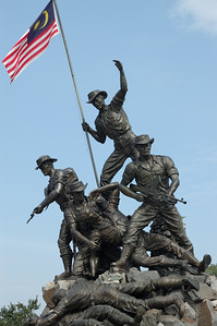 The seven soldiers atop the national monument honour those who had fought (and also those who fell) in World War II and the Emergency of Malaya-War Memorial-Kuala Lumpur-Malaysia