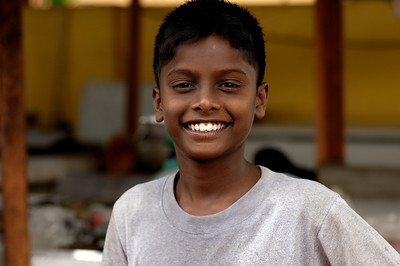 Smiling boy at market: Melaka, Malaysia