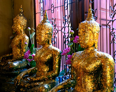 Gold leaf covered Buddhas inside the Golden Buddha temple-Wat Traimit-Bangkok-Thailand