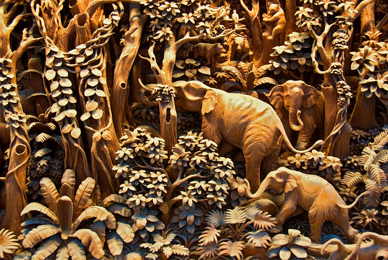 Thai wood carver at work-Wood Carving Factory-Thailand
