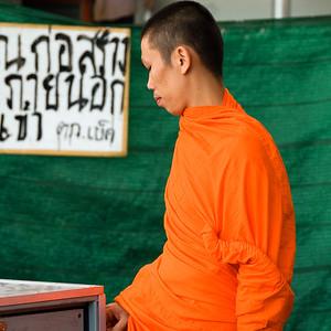 Buddhist monk in saffron robes on sidewalk-Grand Palace-Bangkok-Thailand