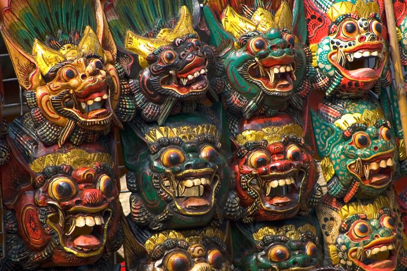 Colorful carved wooden masks of demons-Damnoen Saduak Floating Market-Thailand