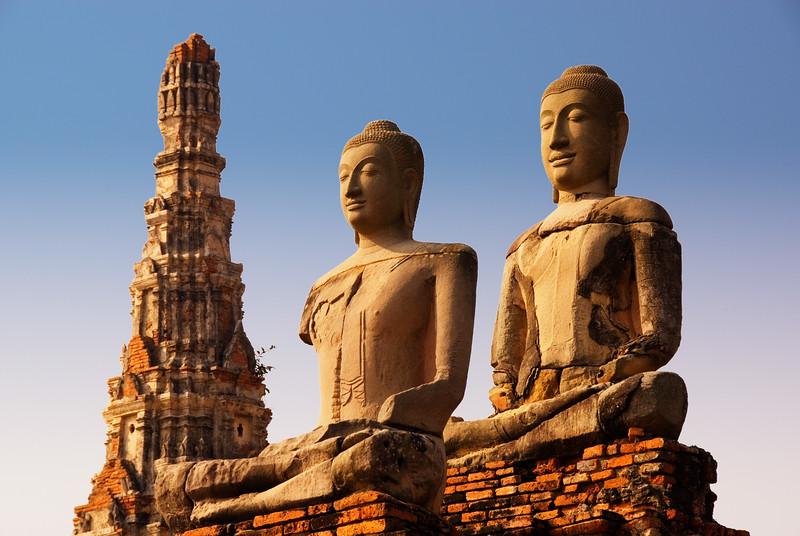 Statues of Buddha silhoutted against sky-Wat Chai Wattanaram-Ayutthaya-Thailand