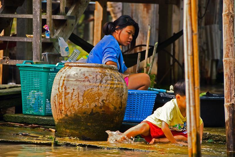 Boat dock on canal-Canal Near Damnoen Saduak Floating Market-Thailand