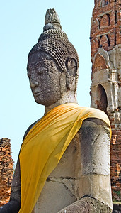 Buddha statue with yellow robe-Wat Mahathat-Ayutthaya-Thailand