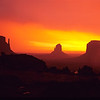 Sunrise during rain storm with the mittens on left.   Monument Valley, Arizona.