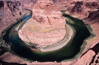 Horseshoe bend on the Colorado river.   This is larger than you may think.  The small dot in the center of river on right is a boat.  The trails on the near side of the peninsula, lead to a blue tent.  Page,  Arizona.