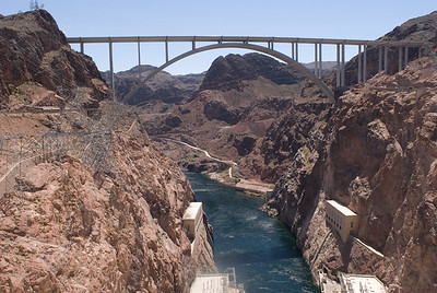 Arch bridge over the Colorado River.  Downstream from Hover dam with generator building at bottom.  Hover dam, Nevada.