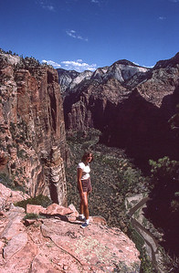 Denise Bumann from top of Eagles nest.   The Virgin river is seen 1500 feet below.  Zion Canyon NP, Utah.  1982