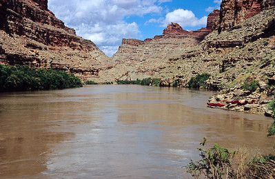 The Green River is not exactly green.  Its to thick to drink but to thin to walk on.     Our kayaks are on right.   Canyonlands NP, Utah.