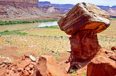 Balanced rock with Green river in background.  Near Cabin Bottom,  Green River, Utah.