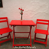 Red chairs at an Arcos restaurant.