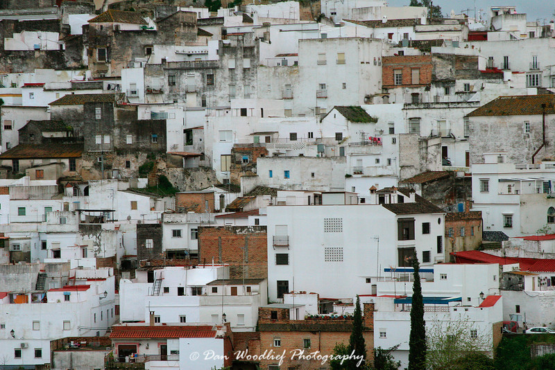 Arcos buildings stacked up along the hill.