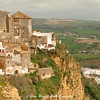 A cliffside view of Arcos towering above the surrounding plains.