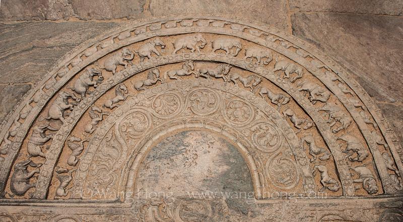 A sandakada pahana (moon stone) at one of the entrances at Polonaruwa Vatadage..It symbolises the cycle of Saṃsāra in Buddhism