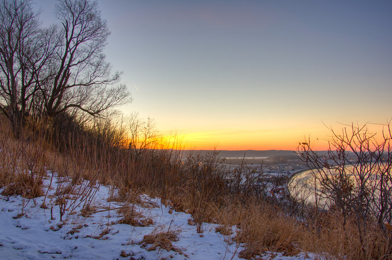 Sun Rises Behind Indian Mounds Park
