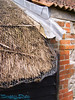 Thatching and lead gutters.